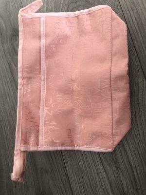 Bolso tipo marsupio color rosa dorado