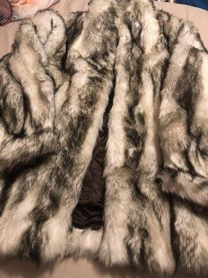 Giacca in eco pelliccia nero-bianco