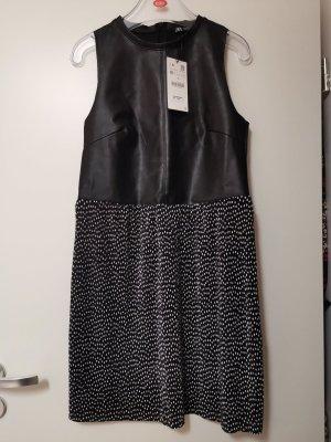 Kunstleder Kleid mit gepunkteten Plissee Rockteil Gr. M