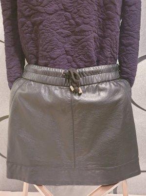 Kunstlederrock, seitliche Taschen, sportlich, schick