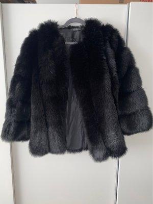 Veste en fourrure noir