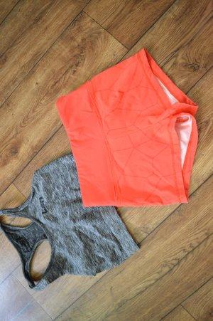 Pantalón corto deportivo rojo claro