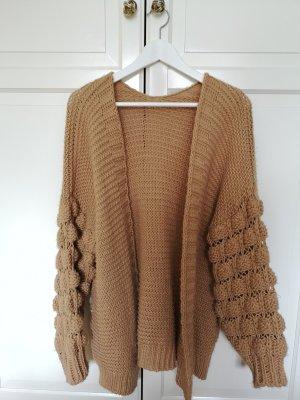Veste tricotée en grosses mailles chameau