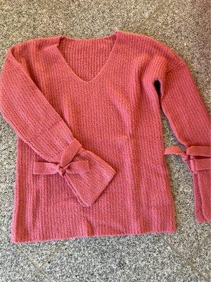 Kuschelpulli mit Ärmelschleifen rosa