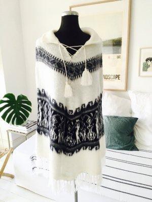 Poncho blanco puro-negro tejido mezclado