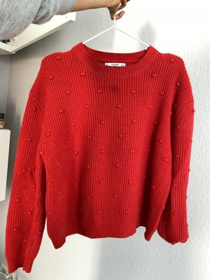 Kuschliger roter Pullover