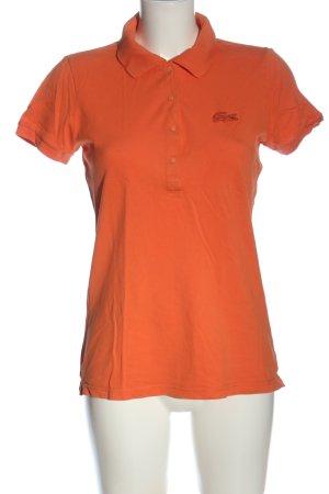 Lacoste Camiseta tipo polo rojo estampado repetido sobre toda la superficie