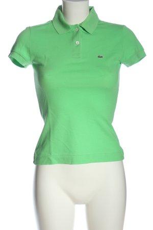 Lacoste Camiseta tipo polo verde letras bordadas look casual