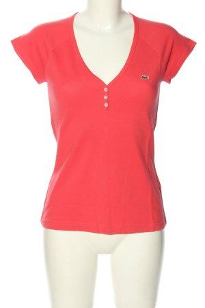 Lacoste Camiseta tipo polo rosa look casual