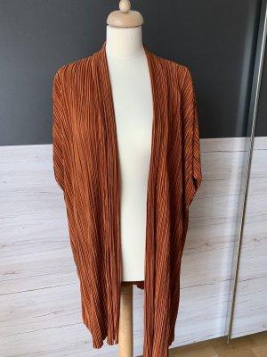 Gilet long tricoté rouille