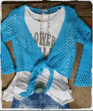 Cardigan en crochet turquoise