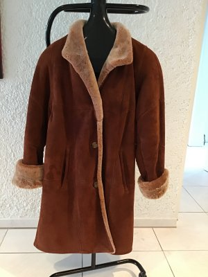 Manteau de fourrure cognac-beige