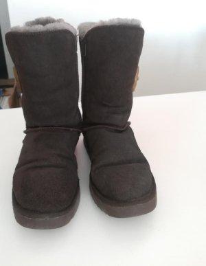 Botas de piel marrón tejido mezclado