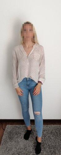 Glanzende blouse licht beige