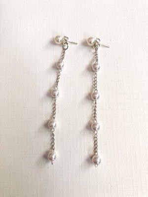 Boucles d'oreilles en perles blanc-argenté