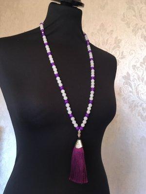 Lange Perlenkette mit Anhänger und Quaste aus dem Iran