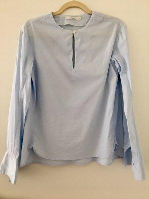 Lareida Bluse hellblau mit weißer Paspel