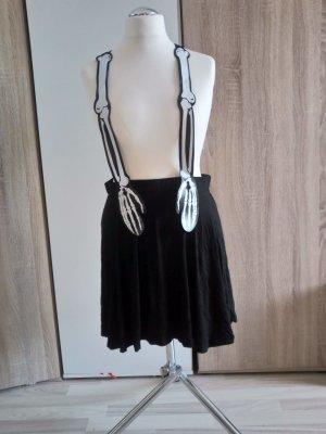 Falda tipo overol blanco-negro