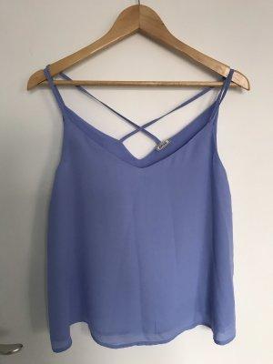 Lavendellila/blaue Bluse