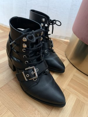 Steve Madden Cut Out Booties black leather