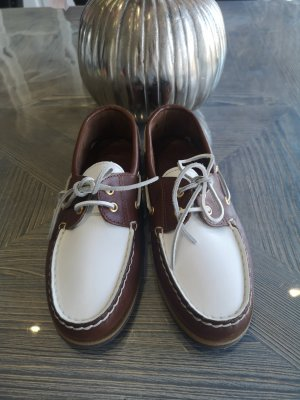 Moccasins white-brown