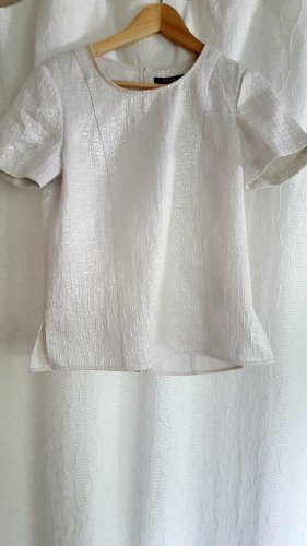Leicht glitzerne Bluse mit Schlitzen am Rücken
