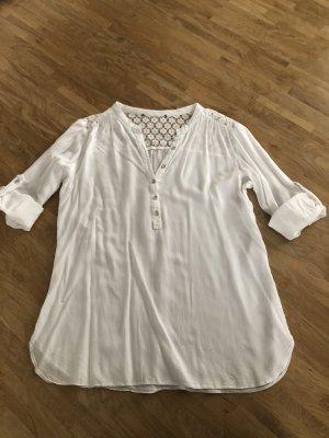 Blusa in merletto bianco