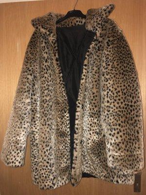 Manteau de fourrure beige-noir