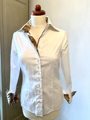 Les salons des femmes: weiße Bluse, abgesetzt  mit braunem gemustertein der Größe 36
