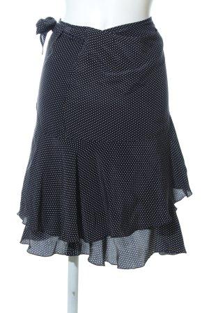Falda cruzada negro-blanco estampado repetido sobre toda la superficie