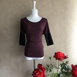 Blusa de cuero negro-violeta amarronado