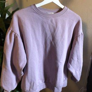lila sweatshirt mit voluminösen Ärmeln