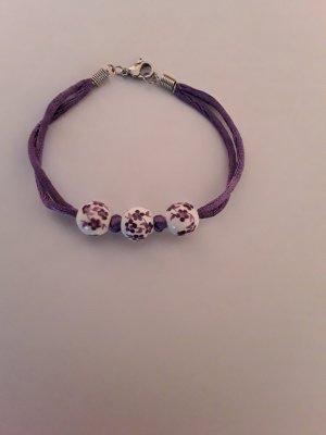 Lila weißes Perlen Armband