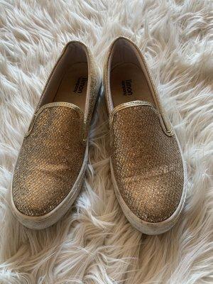 Zapatos sin cordones color oro-blanco