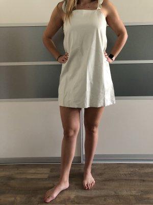 Lockeres weißes Kleid aus Kunstleder