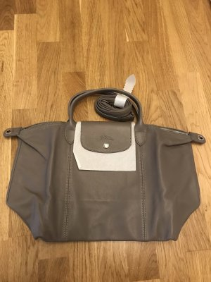 Longchamp depose Le pliage leather beige cuir
