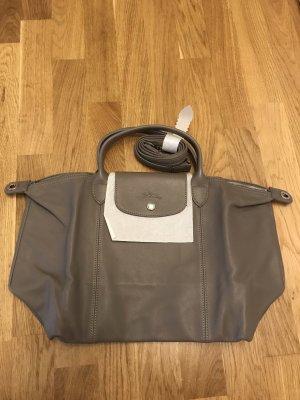 Longchamp depose Le pliage leather beige cuir