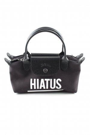 Longchamp Handtasche schwarz-weiß Schriftzug gedruckt Business-Look