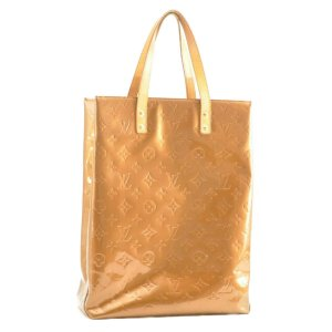 Louis Vuitton Bolso color oro Cuero