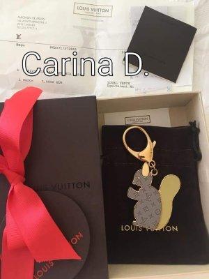Louis Vuitton Llavero color oro-marrón arena
