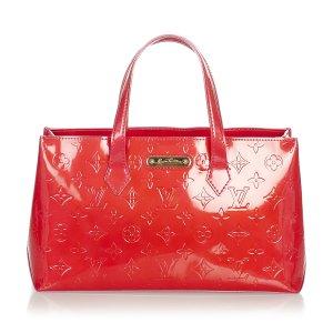 Louis Vuitton Sac à main rouge faux cuir