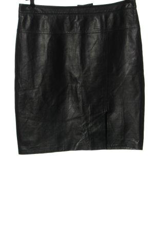 Madeleine Falda de cuero negro look casual