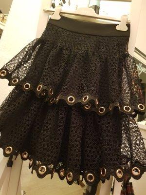 Maje Falda de encaje negro-color oro
