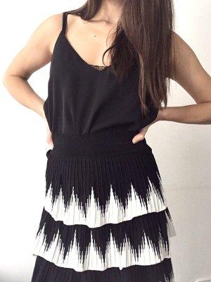 Maje Falda plisada blanco-negro tejido mezclado