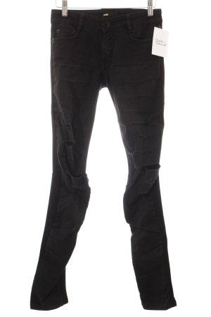Maje Skinny Jeans schwarz Used-Optik