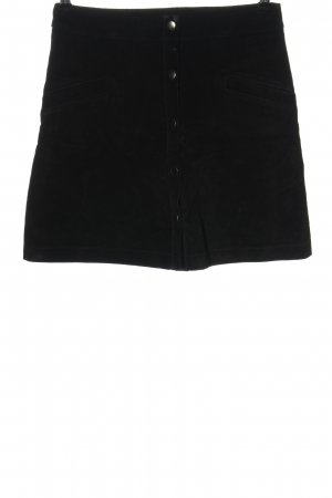 Mango Falda de cuero negro look casual