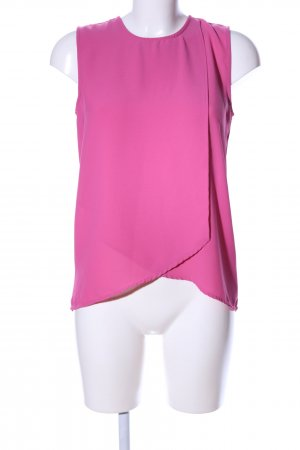 Mango Suit Blusa sin mangas rosa look casual