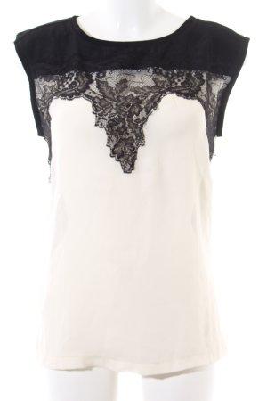 Mango Suit Kurzarm-Bluse schwarz-wollweiß Blumenmuster Business-Look