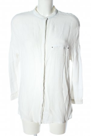 Mango Suit Blusa de cuello alto blanco look casual