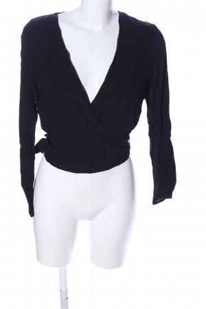 Mango Suit Blusa cruzada negro look casual